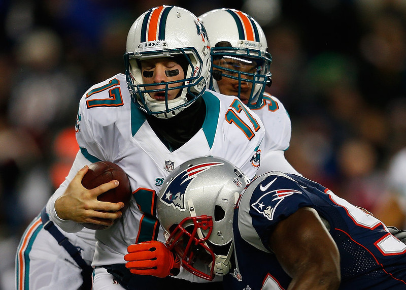 . Ryan Tannehill #17 of the Miami Dolphins is sacked by Justin Francis #94 of the New England Patriots in the first quarter  at Gillette Stadium on December 30, 2012 in Foxboro, Massachusetts. (Photo by Jim Rogash/Getty Images)