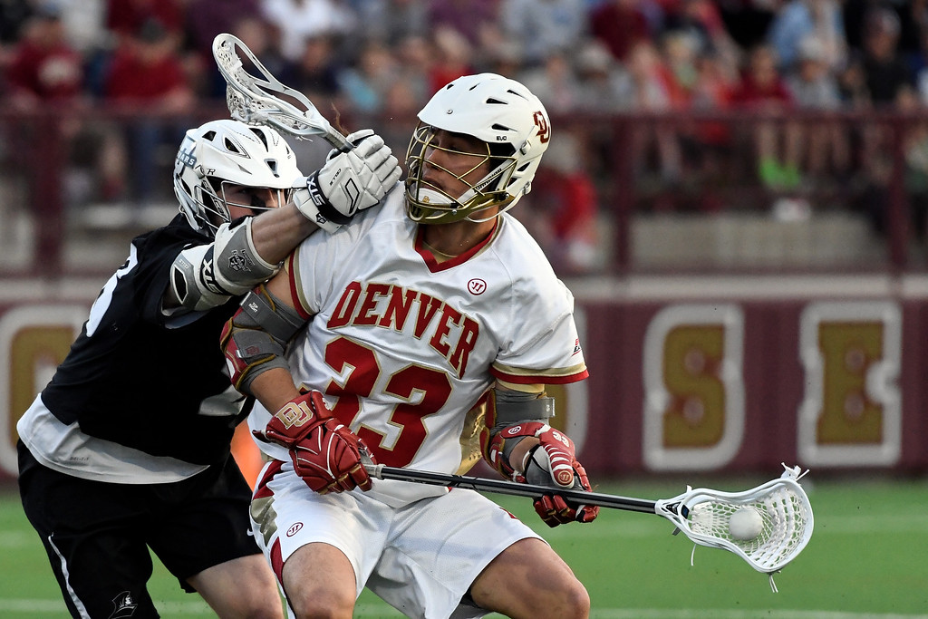 . DENVER, CO - MAY 05: Providence Conner Byrne (26) puts a hit on Denver Zach Miller (33) as he controls the ball during the first period in a Big East semifinal game May 5, 2016 at Peter Barton Lacrosse Stadium. (Photo By John Leyba/The Denver Post)