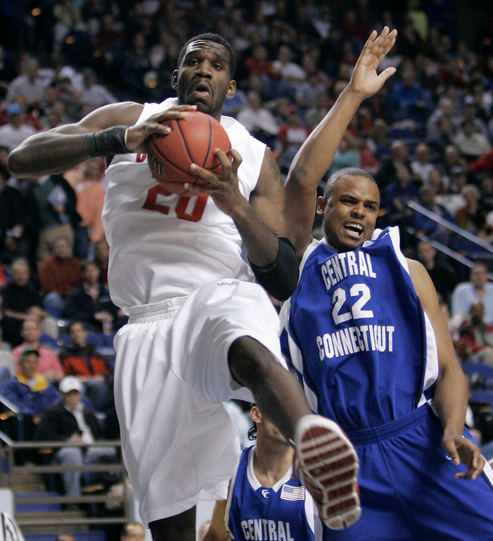 . Ohio State center  Greg Oden, l eft, pulls down a rebound in front of Central Connecticut\'s Jemino Sobers during the first half of an NCAA Tournament South Regional first-round basketball game in Lexington, Ky., Thursday, March 15, 2007.  (AP Photo/Al Behrman)
