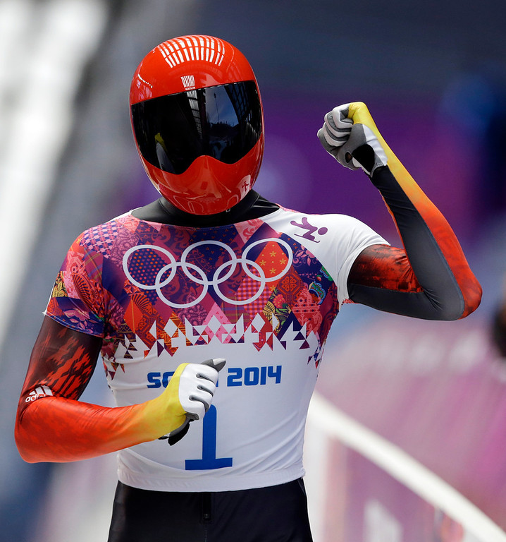 . Frank Rommel of Germany pumps his fist after his second run during the men\'s skeleton competition at the 2014 Winter Olympics, Friday, Feb. 14, 2014, in Krasnaya Polyana, Russia. (AP Photo/Dita Alangkara)