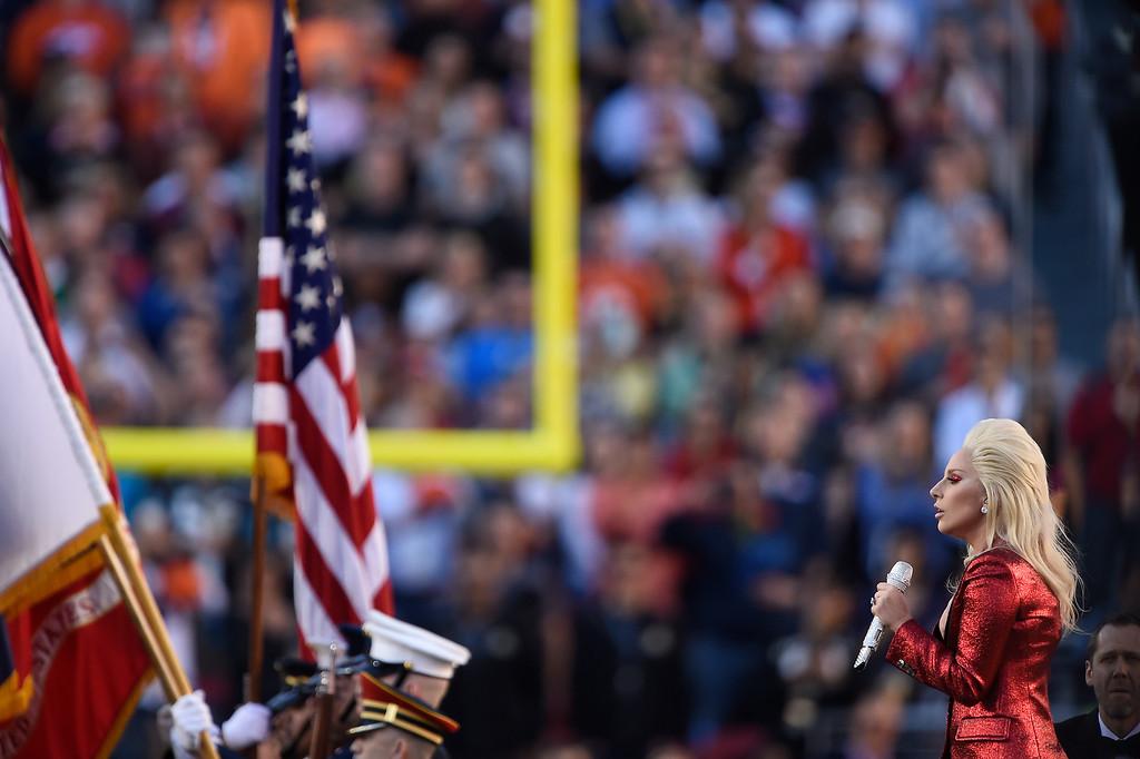 . SANTA CLARA, CA - FEBRUARY 07: Lady Gaga sings the national anthem. The Denver Broncos played the Carolina Panthers in Super Bowl 50 at Levi\'s Stadium in Santa Clara, Calif. on February 7, 2016. (Photo by Joe Amon/The Denver Post)