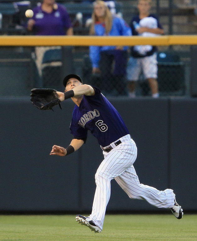 . Leftfielder Corey Dickerson #6 of the Colorado Rockies catches a fly ball for a put out on Jon Jay #19 of the St. Louis Cardinals in the first inning at Coors Field on September 16, 2013 in Denver, Colorado.  (Photo by Doug Pensinger/Getty Images)