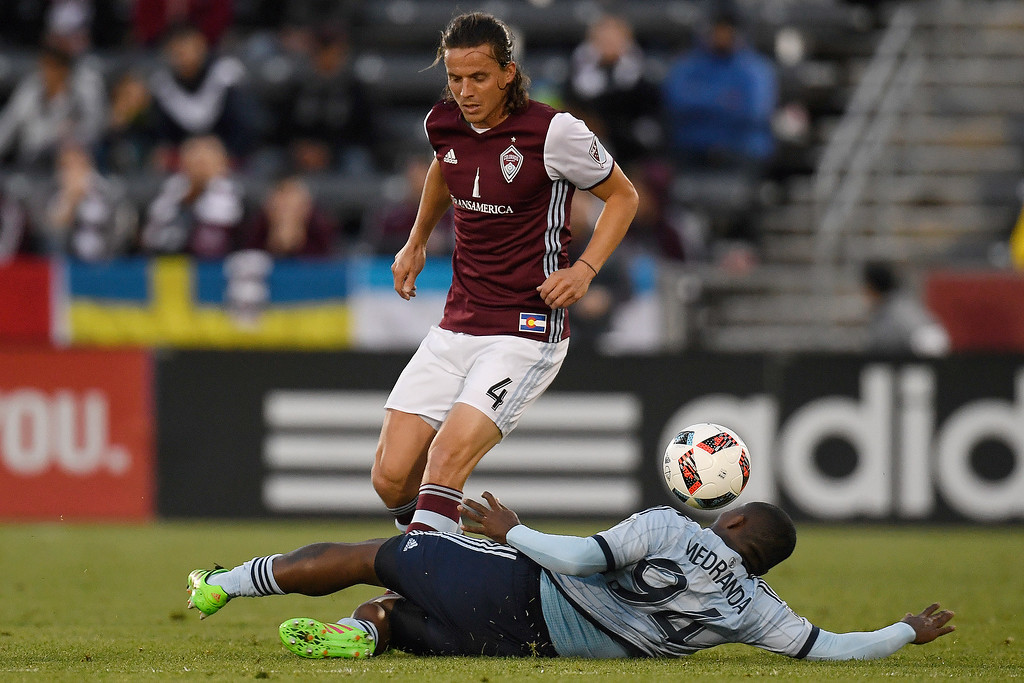. COMMERCE CITY, CO - MAY 11: Jimmy Medranda (94) of Sporting Kansas City defends Marc Burch (4) of Colorado Rapids during the first half of action. The Colorado Rapids hosted Sporting Kansas City on Wednesday, May 11, 2016. (Photo by AAron Ontiveroz/The Denver Post)