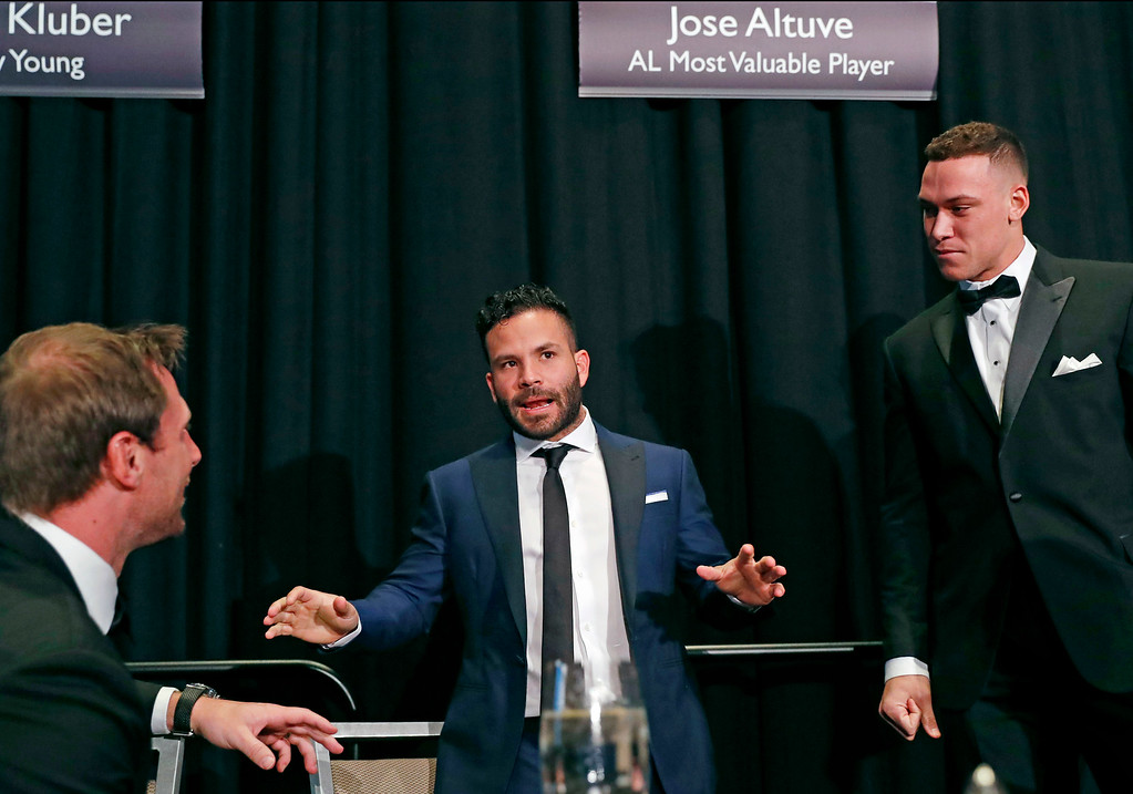 . American League Most Valuable Player Jose Altuve of the Houston Astros, center, speaks as National League Cy Young Award winner Max Scherzer, left, of the Washington Nationals, and American League Rookie of the Year Award winner Aaron Judge of the New York Yankees, listen during the New York Chapter Baseball Writers\' Association of America annual dinner in New York, Sunday, Jan. 28, 2018. (AP Photo/Kathy Willens)