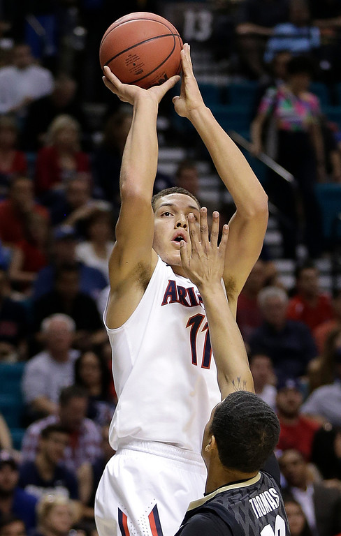 . Arizona\'s Aaron Gordon shoots against Colorado\'s Dustin Thomas during the first half of an NCAA college basketball game in the semifinals of the Pac-12 Conference on Friday, March 14, 2014, in Las Vegas. (AP Photo/Julie Jacobson)