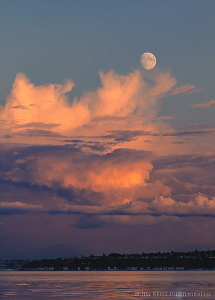 Tonight's pleasant surprise was the moon popping up over the distant storm clouds!