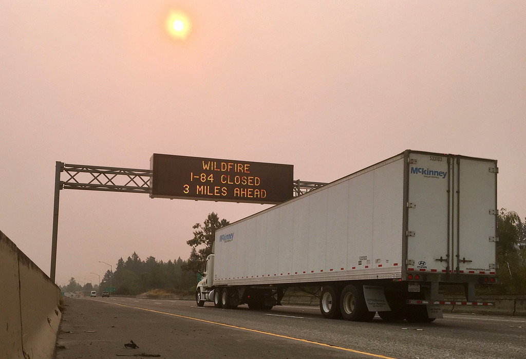 . A sign warns of a highway closure on Interstate 84 in Troutdale, Ore., Tuesday, Sept. 5, 2017. A lengthy stretch of the highway east of Portland, Ore., remains closed Tuesday morning as crews battle a growing wildfire that has also caused evacuations and sparked blazes across the Columbia River in Washington state. (AP Photo/Gillian Flaccus)