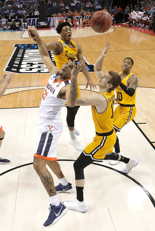 . Virginia\'s Isaiah Wilkins (21) and UMBC\'s Joe Sherburne (13) look for a rebound during the first half of a first-round game in the NCAA men\'s college basketball tournament in Charlotte, N.C., Friday, March 16, 2018. (AP Photo/Gerry Broome)