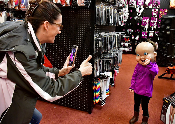 10/30/2019 Mike Orazzi | StaffrKristine Caco and her daughter Danika,4, while picking out a costume at Spirit Halloween in Plainville on Wednesday afternoon.