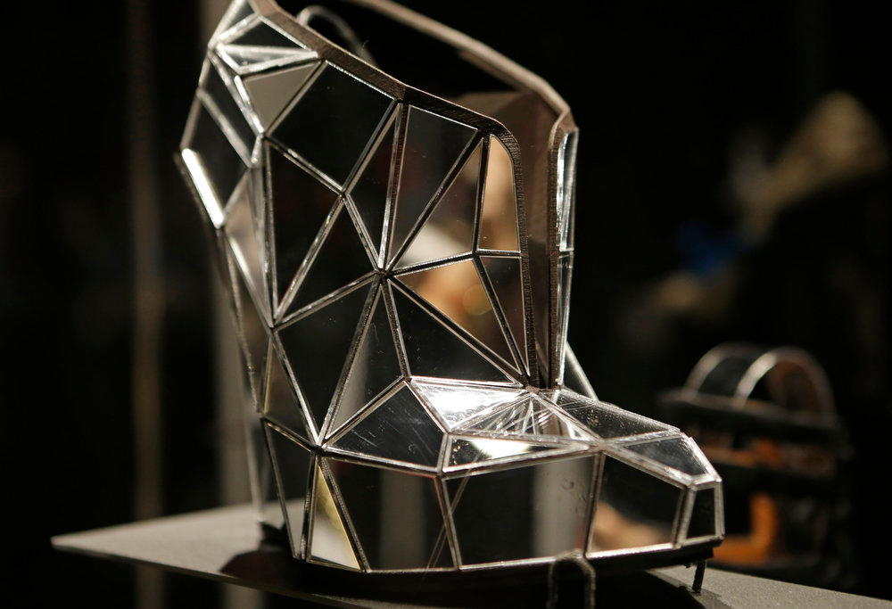 Description of . A shoe, made of mirror fragments titled