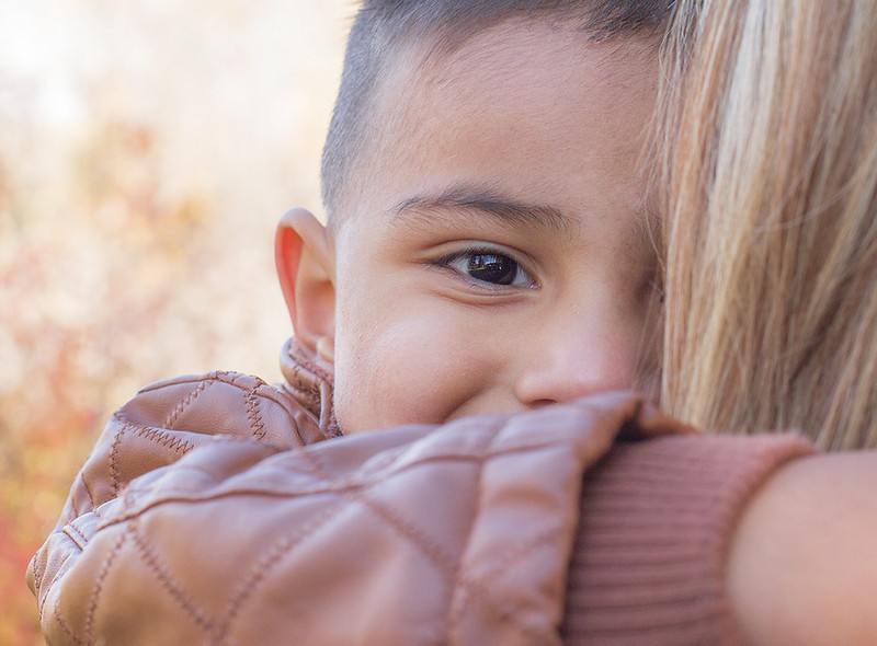 little boy looking at camera during family photo session in boise idaho.jpg