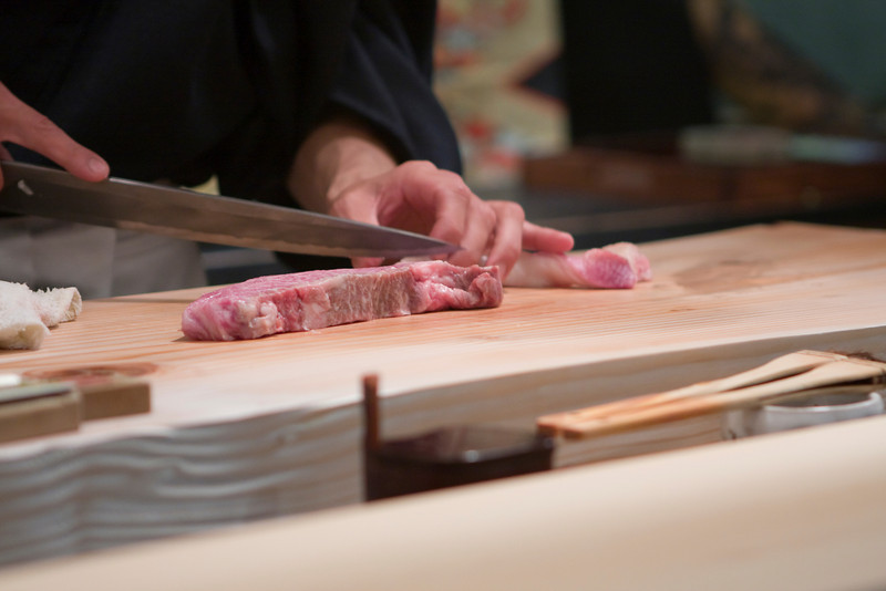 Hiro preparing the kobe beef.  This is also later used in shabu shabu.  He is cutting out the fat.