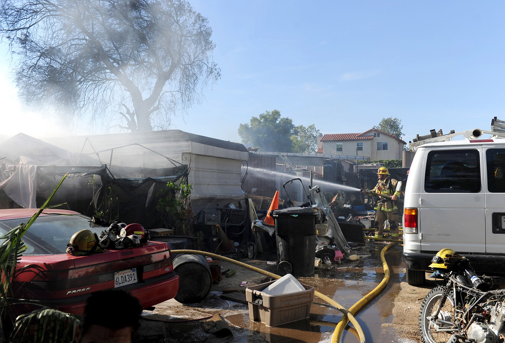 . San Bernardino County Firefighters respond to a three alarm fire in the 18000 block of Bloomington,Ca., Tuesday April 29, 2014 . (Photo by John Valenzuela/The Sun)