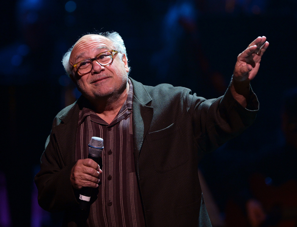 Description of . Actor Danny DeVito speaks onstage during a celebration of Carole King and her music to benefit Paul Newman's The Painted Turtle Camp at the Dolby Theatre on December 4, 2012 in Hollywood, California.  (Photo by Michael Buckner/Getty Images for The Painted Turtle Camp)