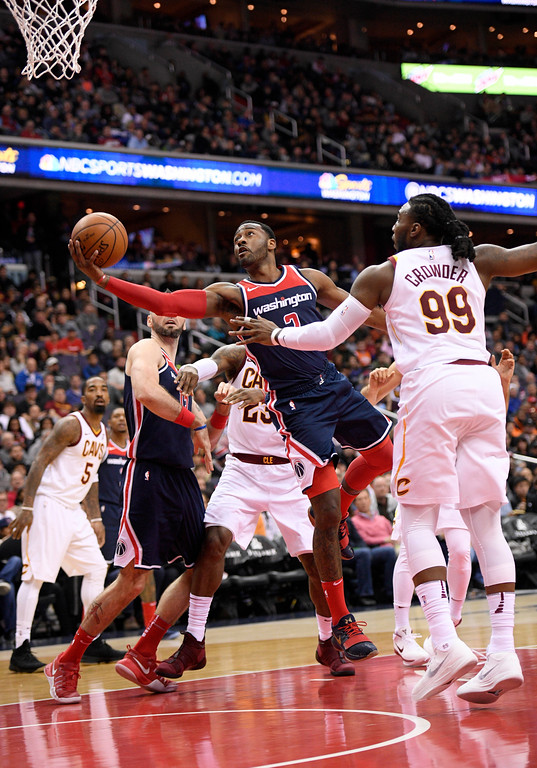 . Washington Wizards guard John Wall (2) goes to the basket against Cleveland Cavaliers forward Jae Crowder (99) during the second half of an NBA basketball game, Sunday, Dec. 17, 2017, in Washington. (AP Photo/Nick Wass)