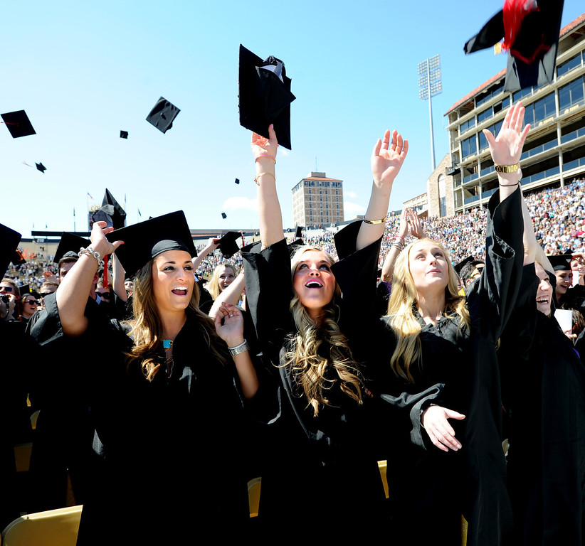 . Journalism graduates, Jenna Klein, left, Samantha Tyson and Rebecca Irwin, celebrate by throwing up their caps  during the 2013 University of Colorado Spring Commencement on Friday in Boulder, Colorado, May 10, 2013. (AP Photo/The Daily Camera, Cliff Grassmick)