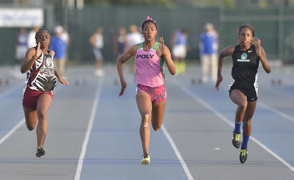 . NORWALK, CALIF. USA -- Poly\'s Arianna Washington, center, competes in the 400 meter dash with Claremont\'s Brittany Brown, left, and Aliso Niguel\'s Danielle Dardon, right, during the CIF-SS Masters Track and Field Meet in Norwalk, Calif., on Friday, May 24, 2013. Photo by Jeff Gritchen / Los Angeles Newspaper Group