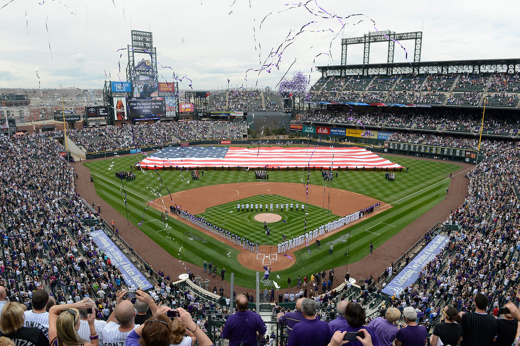 . The flag is displayed during the National Anthem before the start of the game. (Photo by Andy Cross/The Denver Post)