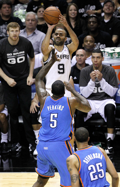 . Tony Parker #9 of the San Antonio Spurs shoots over Kendrick Perkins #5 of the Oklahoma City Thunder in the first half in Game One of the Western Conference Finals during the 2014 NBA Playoffs at AT&T Center on May 19, 2014 in San Antonio, Texas.  (Photo by Chris Covatta/Getty Images)