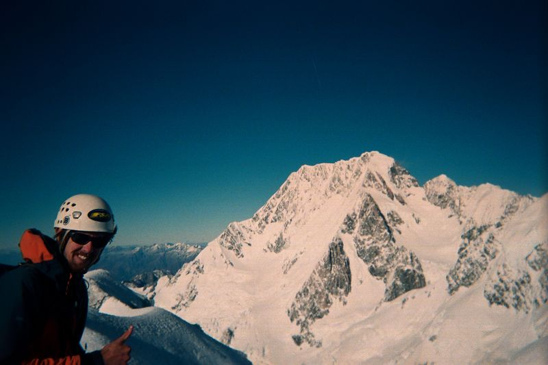 Phil on Mt Dixon with Mt Cook in the background. West face up and East ridge down. 29 Mar 04