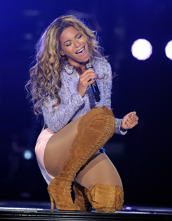 ". Singer Beyonce performs on the opening night of her ""Mrs. Carter Show World Tour 2013\"", on Monday, April 15, 2013 at the Kombank Arena in Belgrade, Serbia. Beyonce is wearing a lilac hand beaded jacket and boots by Pucci. (Photo by Frank Micelotta/Invision for Parkwood Entertainment/AP Images)"