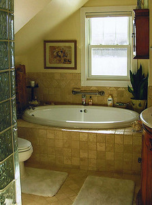 The upstairs bathroom with a jet tub.  A shower can be seen at the extreme left.