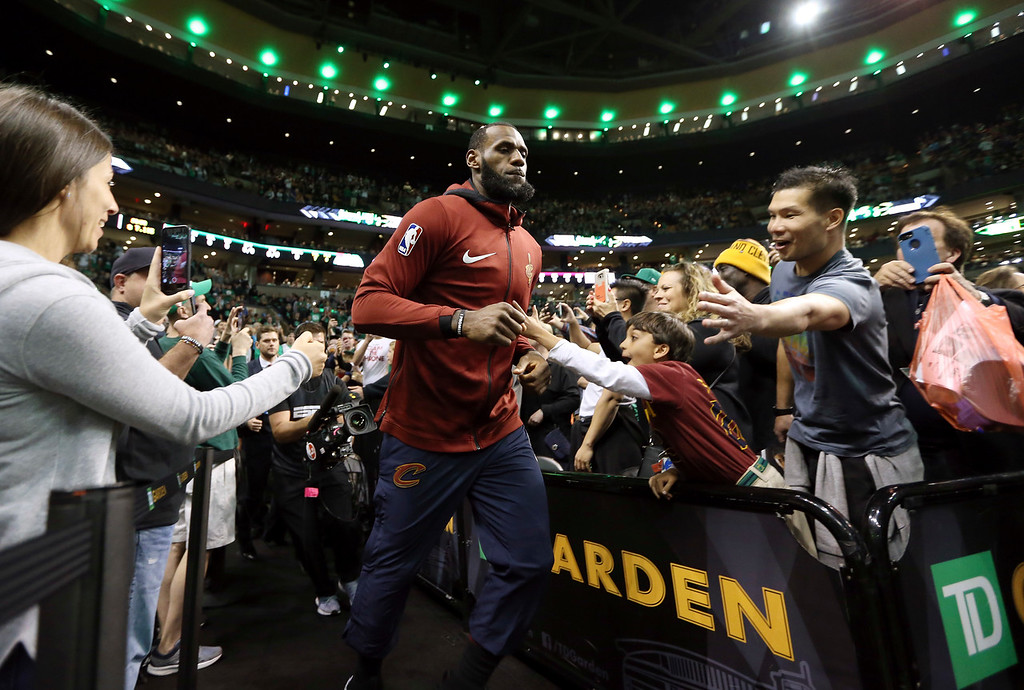 . Cleveland Cavaliers forward LeBron James, center, heads to the court for Game 7 of the NBA basketball Eastern Conference finals against the Boston Celtics, Sunday, May 27, 2018, in Boston. (AP Photo/Elise Amendola)