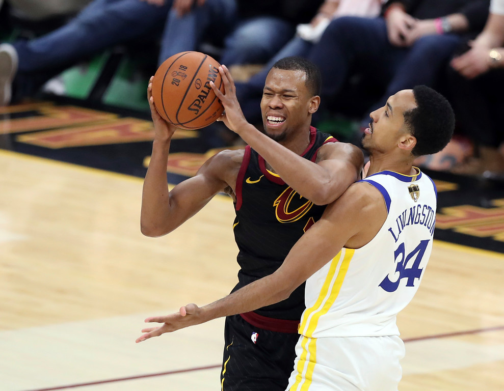 . Cleveland Cavaliers guard Rodney Hood is defended by Golden State Warriors\' Shaun Livingston in the first half of Game 4 of basketball\'s NBA Finals, Friday, June 8, 2018, in Cleveland. (AP Photo/Carlos Osorio)