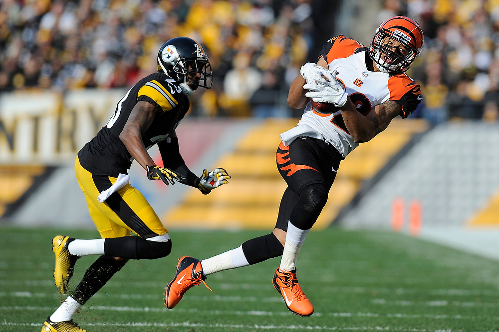 Description of . Cincinnati Bengals wide receiver Marvin Jones makes a catch in front of Pittsburgh Steelers cornerback Keenan Lewis (23) in the first quarter of an NFL football game Sunday, Dec. 23, 2012, in Pittsburgh. (AP Photo/Don Wright)