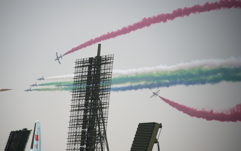 . The United Arab firstst Aerobatic team performs in their MB-339A jets next to a Chinese Radar system on display at the Airshow China 2014 in Zhuhai, south China\'s Guangdong province on November 12, 2014. The 10th Airshow China 2014 takes place from November 11 to 16.   AFP PHOTO / JOHANNES EISELE/AFP/Getty Images