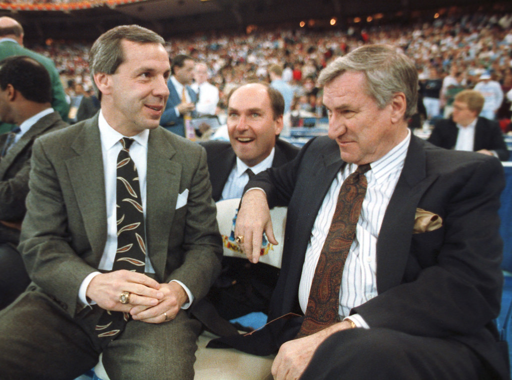 ". FILE - In this March 30, 1991 file photo, Kansas coach Roy Williams, left, and North Carolina coach Dean Smith talk before the start of the first NCAA national semi-final game in Indianapolis, Ind. Smith, the North Carolina basketball coaching great who won two national championships, died ""peacefully\"" at his home Saturday night, Feb. 7, 2015, the school said in a statement Sunday from Smith\'s family. He was 83. (AP Photo/Bob Jordan, File)"
