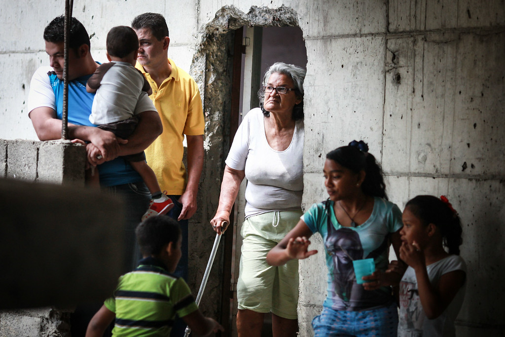 . People wait inside the Tower of David, an abandoned skyscraper in Caracas originally intended to be an office building that became a \'vertical slum\', before being evicted on July 22, 2014. The government began the eviction and relocation of hundreds of families that were illegally occupying the building.  FEDERICO PARRA/AFP/Getty Images