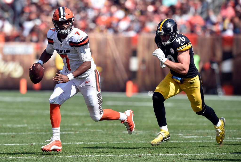 . Cleveland Browns quarterback DeShone Kizer (7) scrambles away from Pittsburgh Steelers linebacker T.J. Watt (90) during the second half of an NFL football game, Sunday, Sept. 10, 2017, in Cleveland. (AP Photo/David Richard)