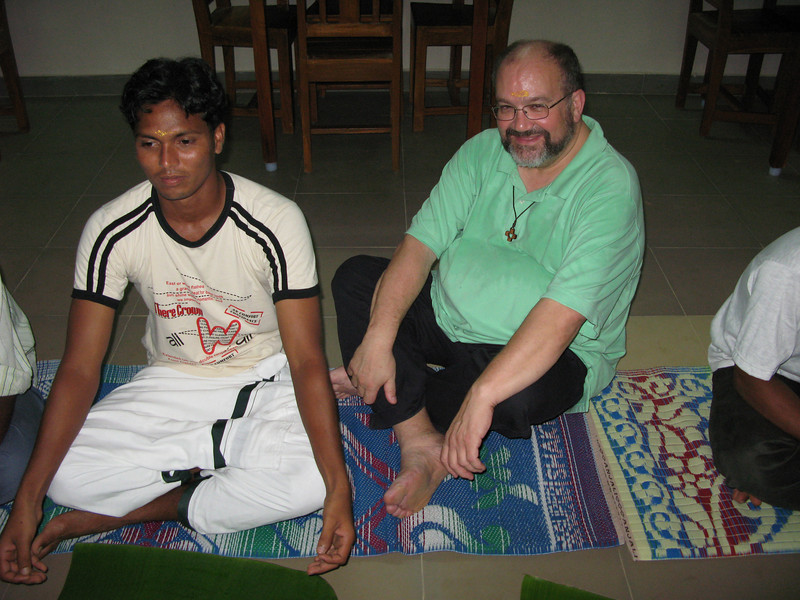 Fr. Charlie (USA) sitting, Indian style.