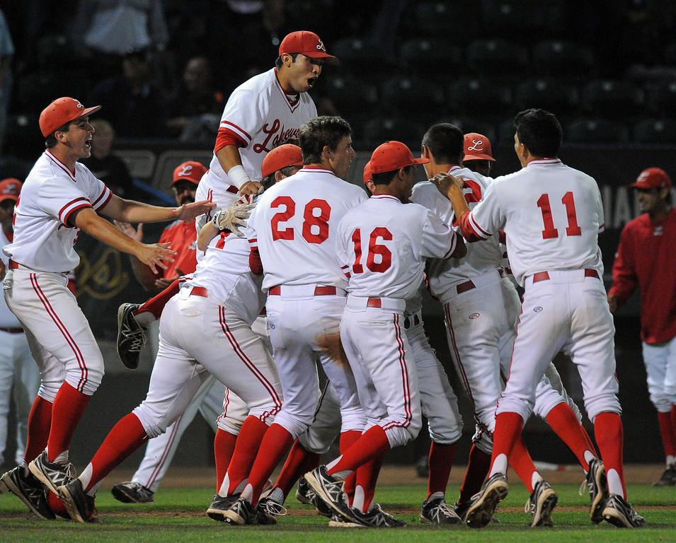 . LONG BEACH - 05/01/13 - (Photo: Scott Varley, Los Angeles Newspaper Group)  Lakewood vs Millikan baseball at Blair Field. Lakewood won 4-3. Lakewood players celebrate their win in the bottom of the 7th.
