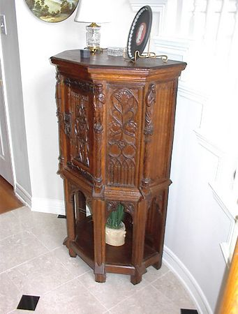 Entry foyer - French gothic style cabinet, circa late 19th century, with elaborate gothic arches in each panel, separated by renaissance style figures carved in each corner