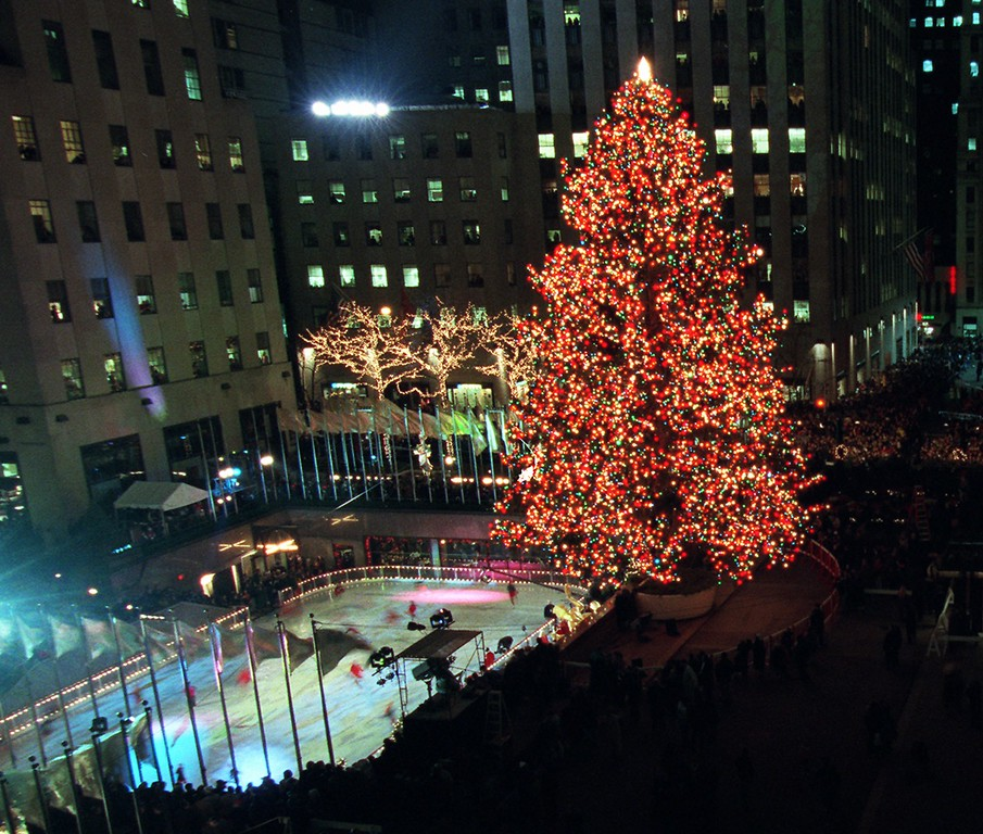 . The Christmas tree in New York\'s Rockefeller Plaza is seen moments after the 26,000 lights decorating it were lit Tuesday night, Dec. 2, 1997.  The 74-foot Norway spuce came from  Stoney Point, N.Y.  (AP Photo/Kathy Willens)