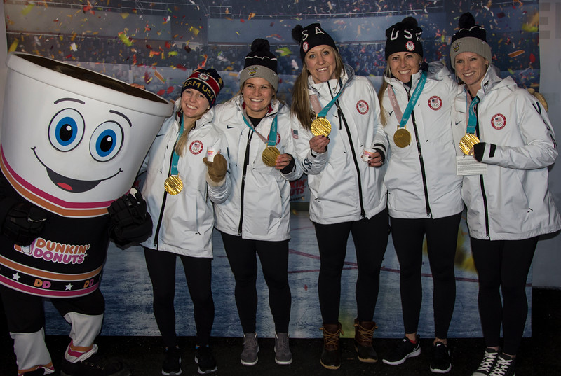 Team with Medals and Cuppy Step Repeat.JPG