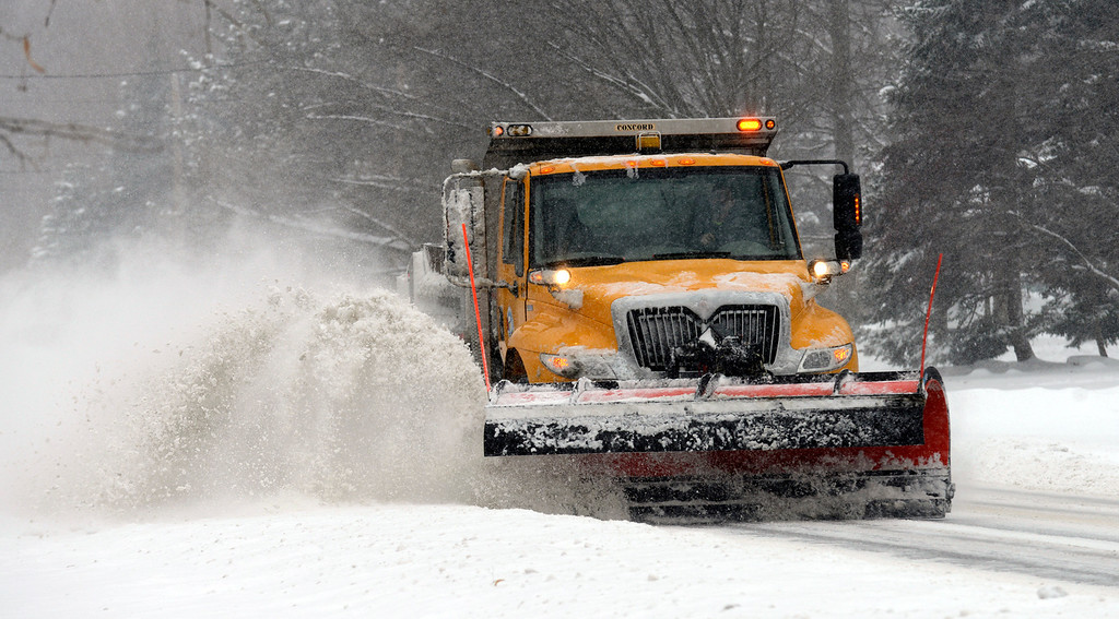 . Maribeth Joeright/MJoeright@News-Herald.com<p> A snow plow clears Hendricks Road in Mentor, Wednesday. Crews worked non-stop to keep up with the rapidly accumulating snow that fell across the region.