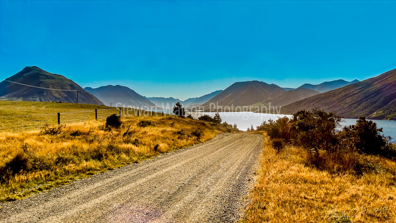 Rural gravel road leading to Lake Coleridge in the South Island of New Zealand