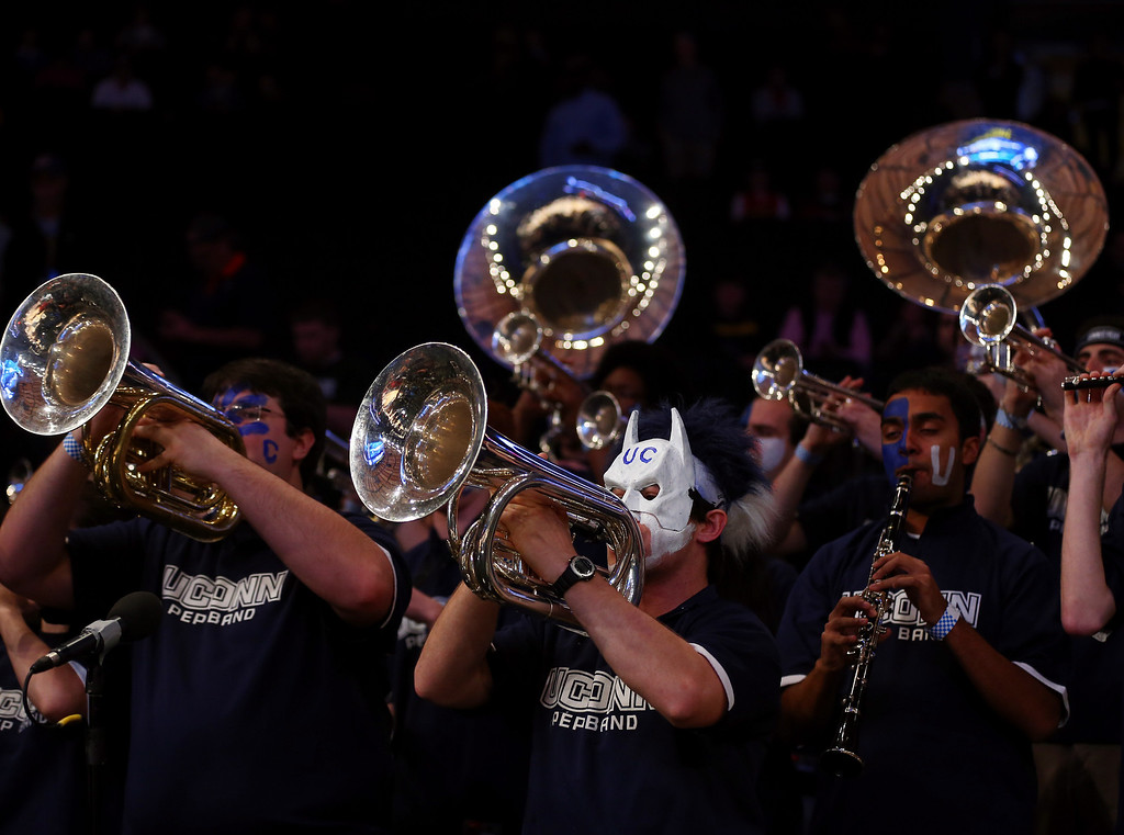 . The Connecticut Huskies band performs during the regional semifinal of the 2014 NCAA Men\'s Basketball Tournament at Madison Square Garden on March 28, 2014 in New York City.  (Photo by Elsa/Getty Images)