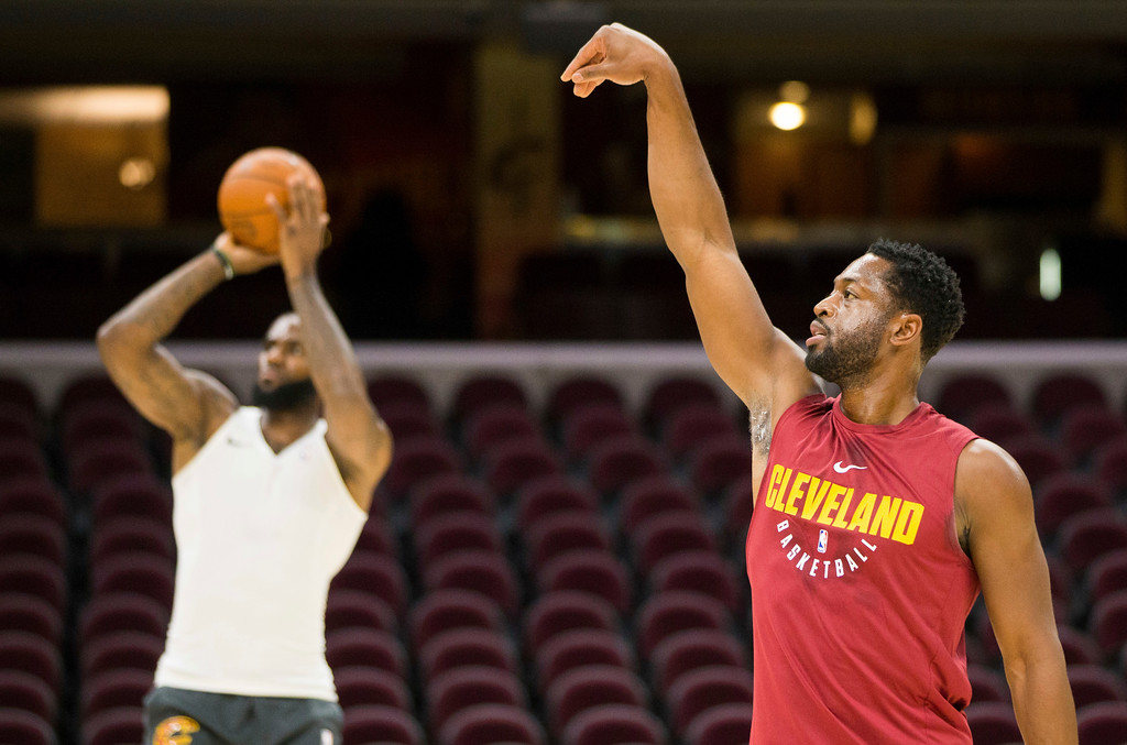 . Cleveland Cavaliers\' Dwyane Wade, right, watches his shot as LeBron James takes a shot during warmups before an NBA preseason basketball game against the Indiana Pacers, Friday, Oct. 6, 2017, in Cleveland. (AP Photo/Scott R. Galvin)
