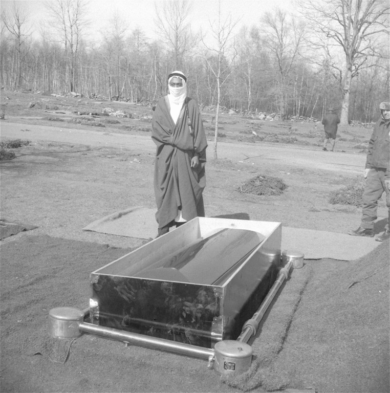 . Imam Alhajj Heshaans Jaaber chants an Islamic prayer as he stands alone beside the casket of Malcolm X at Ferncliff Cemetery in Hartsdale, a New York suburb, February 27, 1965.  Jaaber was joined a short time later by Malcolm\'s widow and other mourners of the slain black nationalist leader.  (AP Photo)