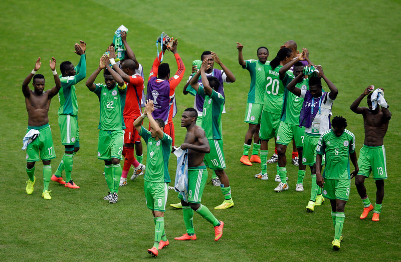 . Nigeria waves to supporters after being defeated by Argentina, 3-2, during the group F World Cup soccer match between Nigeria and Argentina at the Estadio Beira-Rio in Porto Alegre, Brazil, Wednesday, June 25, 2014. (AP Photo/Michael Sohn)