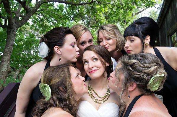 Bridesmaids pucker up to give bride a kiss