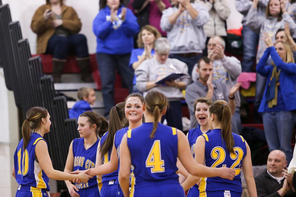 . Carson City-Crystal senior Tori Christiansen, (14) smiles as her team celebrates a victory against Sacred Heart Thursday, Jan. 23, 2014. Carson City-Crystal won 50-23.  (Sun photo by KEN KADWELL/@KenKadwell).