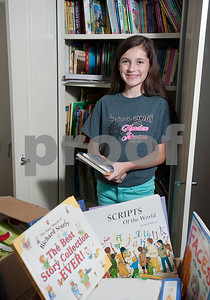 bookworm-girl-collects-donates-2000-books