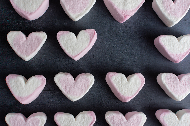 Love heart marshmallows lined up with one missing