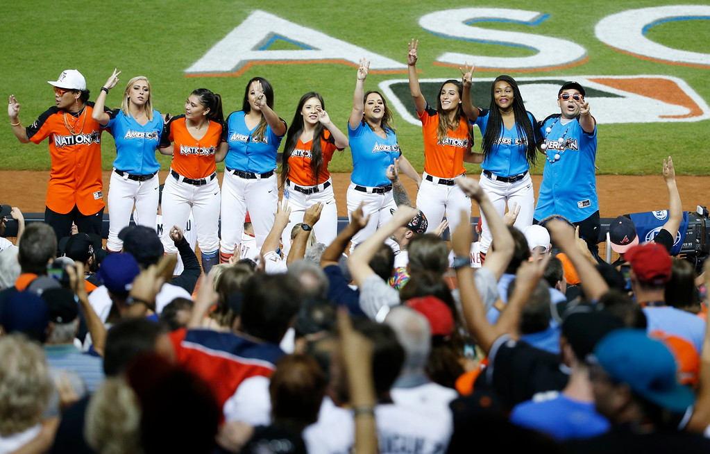 . Members of the Miami Marlins cheerleading team singTake Me Out to the Ballgame, during the seventh inning at the the MLB baseball All-Star Game, Tuesday, July 11, 2017, in Miami. (AP Photo/Wilfredo Lee)