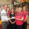 The children of Meigh Pre-school participated in  a fun cycle raising £200 which will be used to buy sensory toys for Rathore School. Pictured with staff Lisa Owens, Ciara McGowan, Sarah Shields, Briget Owens and laura Kenny is Rathore VP Jim O'Hare. R1626004